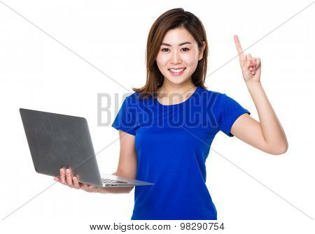 Asian woman hold with notebook computer and finger point up