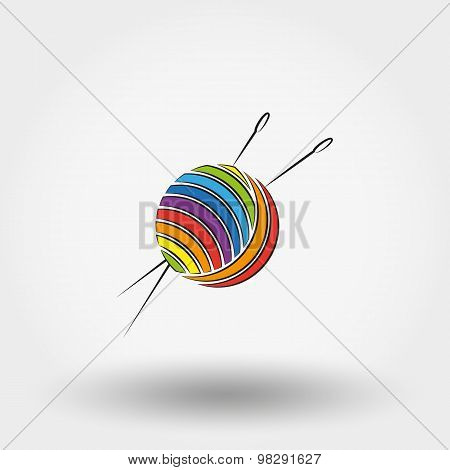 Ball of yarn and needles.