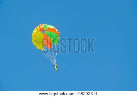 Parachutist Against A Cloudless Blue Sky