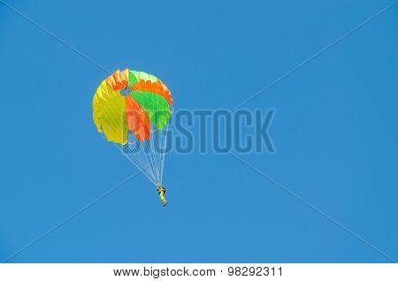 Parachutist Against A Cloudless Blue Sky