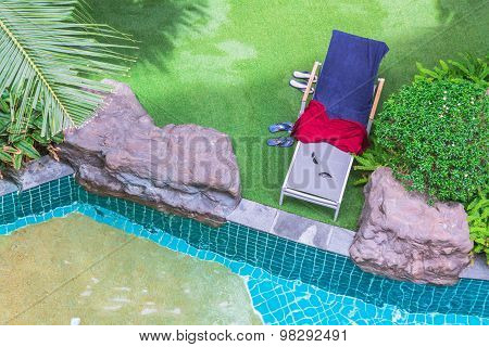 Top view relaxing poolside swimming pool chair.