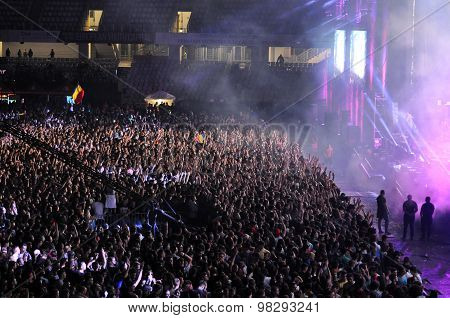 Crowd Of People With Raised Hands At A Concert