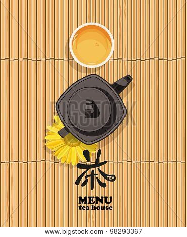Menu bamboo background with cup of chinese tea and teapot.