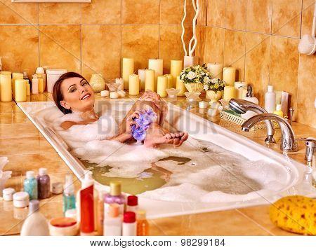 Girl wash leg in bathtube. Women take bath