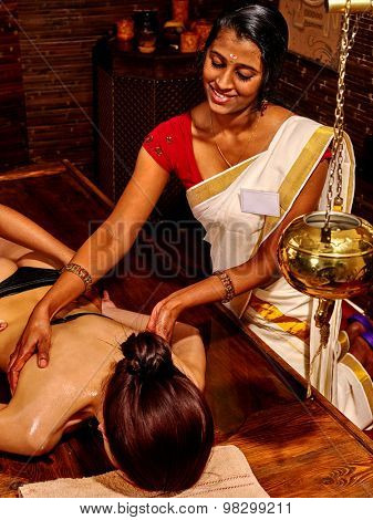 Young woman having oil Ayurveda treatment.Spa resorts in India