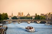 Постер, плакат: Seine River Bridges And Notre Dame Cathedral Paris France