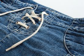 image of jeans skirt  - Blue jeans skirt with lacing close up - JPG