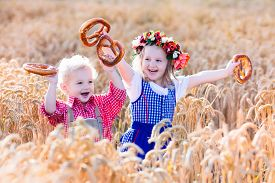 picture of pretzels  - Kids in traditional Bavarian costumes in wheat field - JPG
