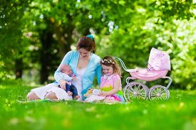 foto of baby doll  - Family with children enjoying picnic outdoors - JPG