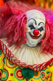 picture of clowns  - Scary clown robot in clown mask on Halloween day - JPG
