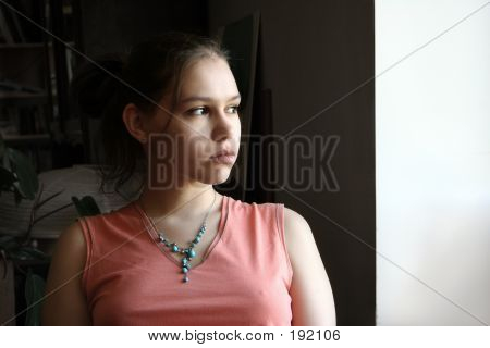 Unhappy Teen By The Window