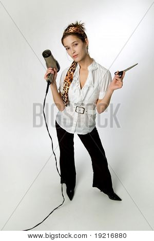 Young Woman Holding Blow Dryer And Scissors.