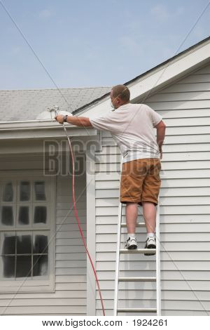 Contractor Spraying House
