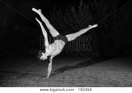 One Arm Balancing Male Dancer