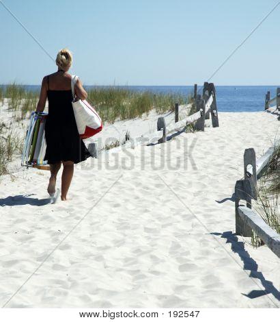 Woman On A  White Sand Path
