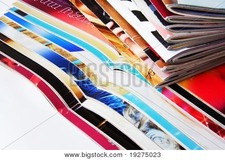 pile of magazines on white