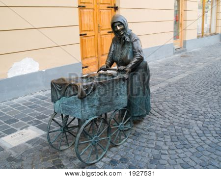 Sculpture Of Old Women In Szekesfehervar.