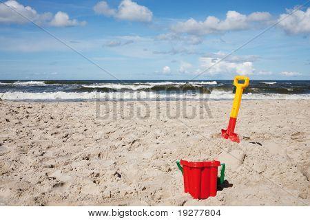 Children's beach toys - buckets, spade and shovel on sand
