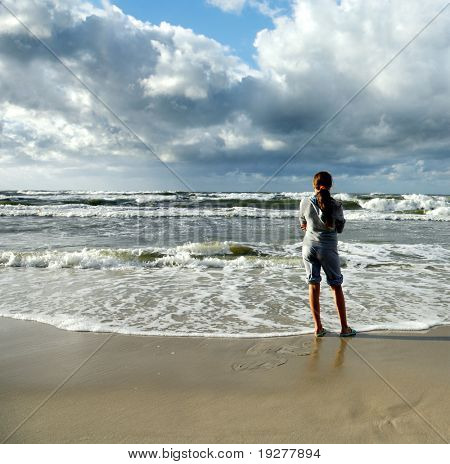 Young Girl looking into stormy sea
