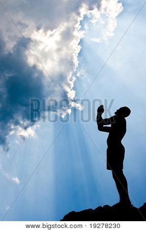 A silhouette of a  Praying man - conceptual image