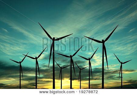 Parque eólico de turbina sobre puesta del sol