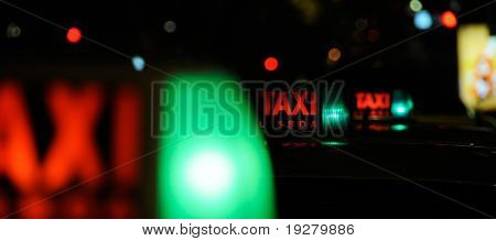 Taxi rank at night - waiting for the next fare
