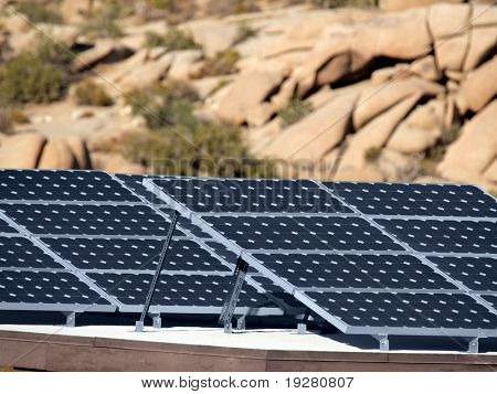 Solar panels and rock formations at Joshua Tree National Park.
