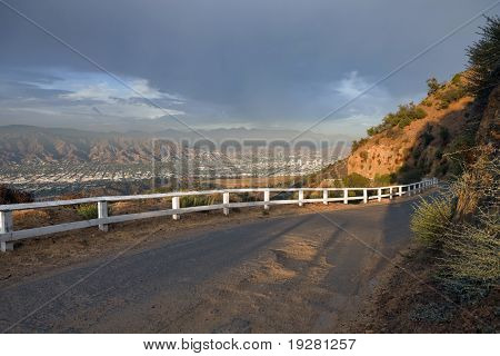Famous Mulholland Hwy with thunder clouds and afternoon light.  High in the hills above Los Angeles Burbank and Glendale, California.