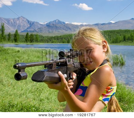 Little girl shooting with airgun