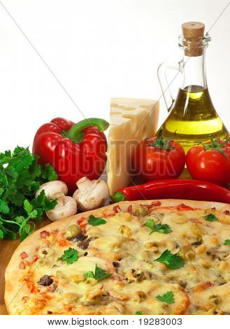 Homemade pizza and ingredients
