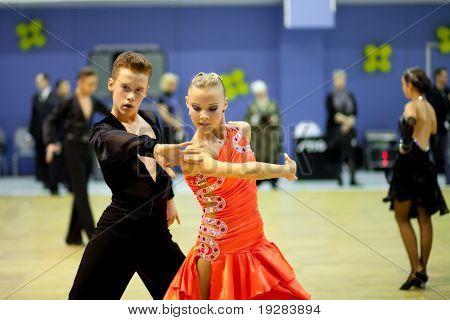 TOMSK, RUSSIA - FEB 14 : Couple dancing - Luk'yancev Aleksey, 16, Zaiceva Yana, 15 (no 58) at sport dance competition of Tomsk region on February 14, 2011 in Tomsk, Russia.