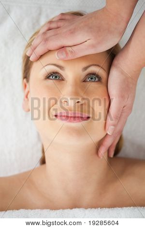 Young blond haired woman having a good time in a spa centre