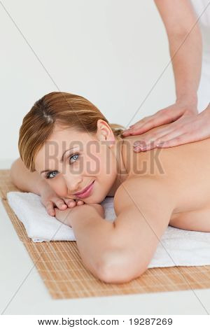 Young blond-haired woman getting a massage