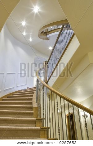 Unique perspective of home's three stories of interconnected stairway.