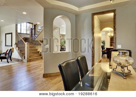 View of home's foyer and entrance with wood floors