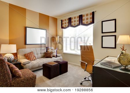 Small office space room with orange accent walls and desk