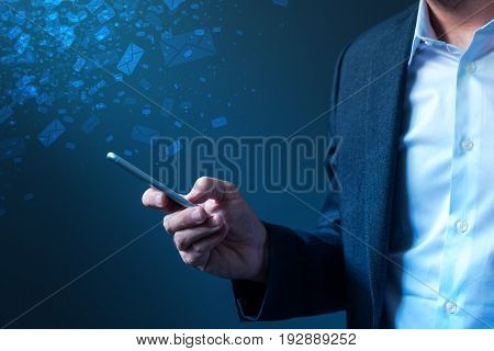 poster of Businessman sending bulk messages using smartphone male business person in elegant suit delivering e-mails newsletters or SMS text messages with his mobile phone app