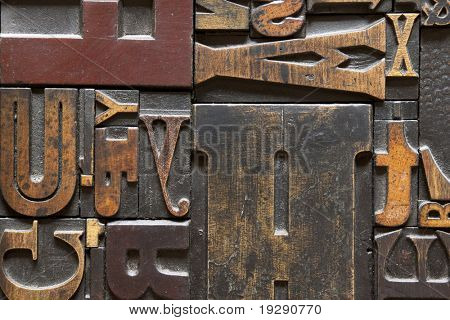 Old printing press letters arranged randomly across. Focus across entire surface.