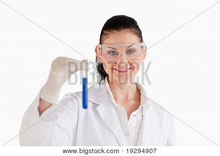 Smiling female scientist looking at the camera