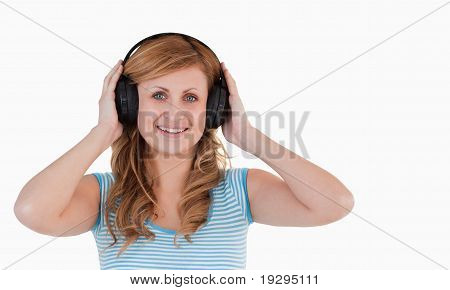 Attractive blond-haired woman listening to music