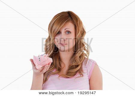Woman sad with her broken piggybank