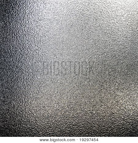 a large sheet of rendered silver or tin foil