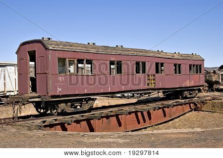 an old train carriage on a turntable