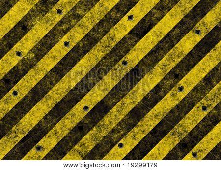 alte grunge gelbe Gefahr-Streifen auf schwarze Straße voller Einschusslöcher