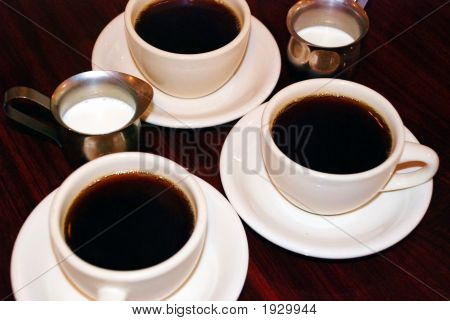 Coffee Cups And Creamer