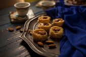 Bulbuls nest - a Middle Eastern sweet dish and Arabic black coffee. Middle eastern food photography  poster