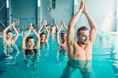 Women aqua aerobics class in water sport center poster