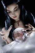 picture of wiccan  - A fortune teller gazes into her crystal ball - JPG