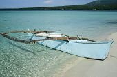 stock photo of camiguin  - outrigger canoe on the white sand beaches of camiguin island in the philippines - JPG