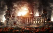 Destroyed Berlin Reichstag building burning with black smoke and flames all around the street. Apoca poster